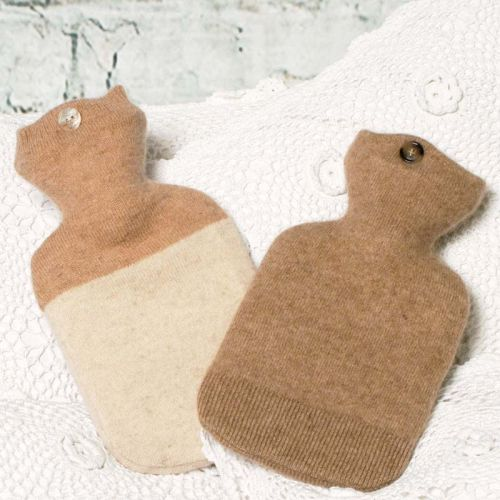 Super soft 100% cashmere,keeping you cosy and warm.  Some of our hot water bottle covers make use of the knitted ribbing or seam work from the original quality cashmere that we use. These shown have different detailing. One comes with ribbing at the